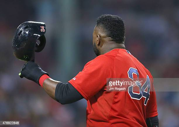 David Ortiz of the Boston Red Sox takes off his helmet after being stranded on base in the eighth inning against Toronto Blue Jays at Fenway Park on...