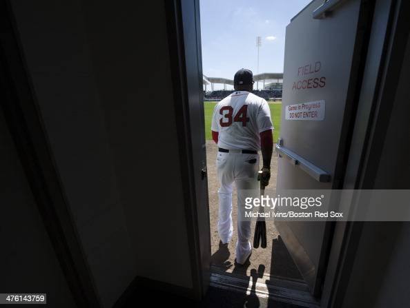 David Ortiz of the Boston Red Sox takes the field before the start of a Grapefruit League game against the Baltimore Orioles at jetBlue Park on March...