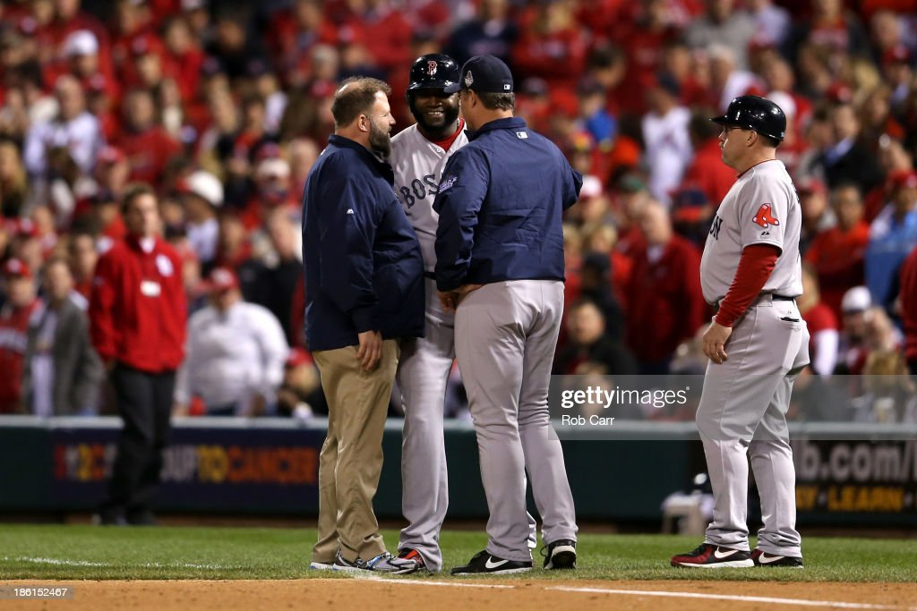 David Ortiz #34 of the Boston Red Sox talks manager John Farrell #53 after hitting a single in the eighth inning against the St. Louis Cardinals during Game Five of the 2013 World Series at Busch Stadium on October 28, 2013 in St Louis, Missouri.