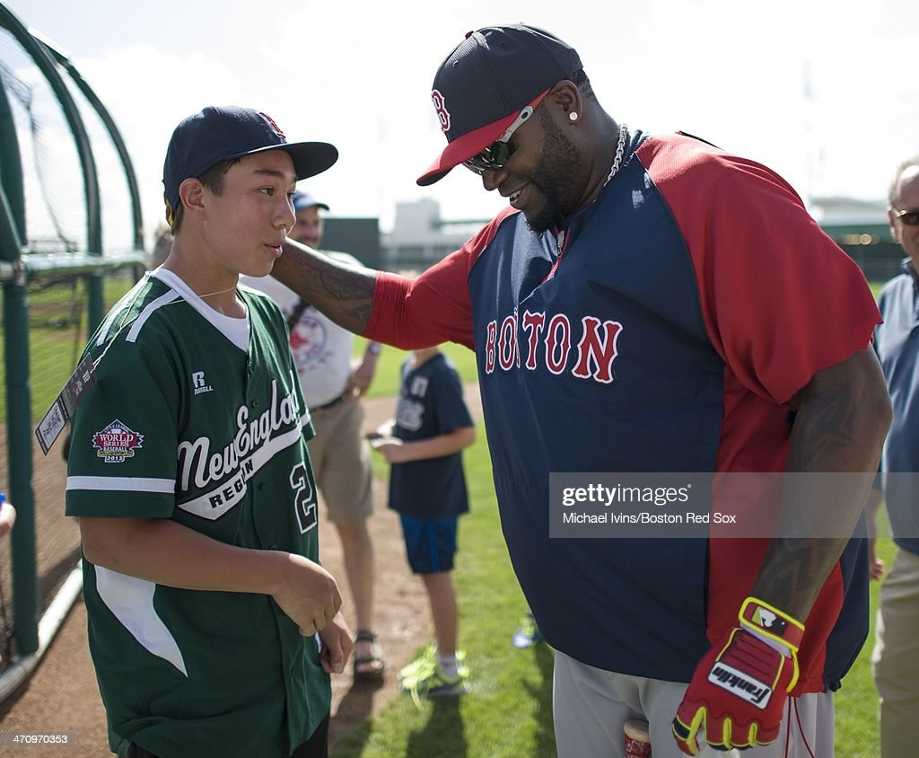 David Ortiz #34 of the Boston Red Sox talks with Chad Knight of Westport, CT during the second full team Spring Training workout at Fenway South on February 21, 2014 in Fort Myers, Florida. Knight was a member of the New England team in the 2013 Little League World Series.