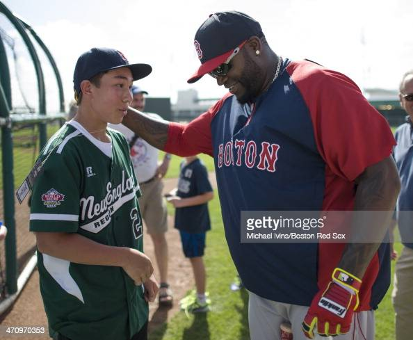 David Ortiz of the Boston Red Sox talks with Chad Knight of Westport CT during the second full team Spring Training workout at Fenway South on...