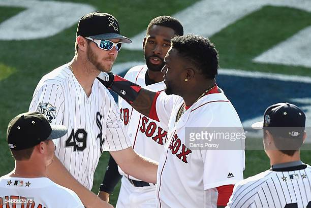 David Ortiz of the Boston Red Sox talks with Chris Sale of the Chicago White Sox during the 87th Annual MLB AllStar Game at PETCO Park on July 12...