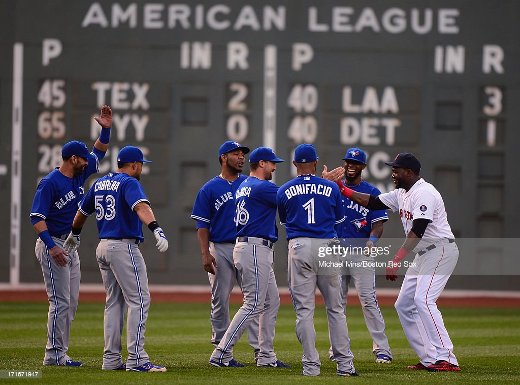 <a gi-track='captionPersonalityLinkClicked' href=/galleries/search?phrase=David+Ortiz&family=editorial&specificpeople=175825 ng-click='$event.stopPropagation()'>David Ortiz</a> #34 of the Boston Red Sox talks with members of the Toronto Blue Jays before the start of a game on June 27, 2013 at Fenway Park in Boston, Massachusetts.