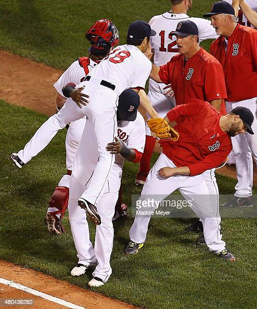 David Ortiz of the Boston Red Sox throws Koji Uehara over his shoulder following the game against the New York Yankees at Fenway Park on July 11 2015...