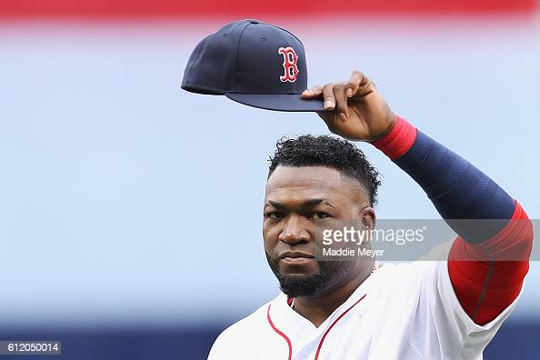 David Ortiz of the Boston Red Sox tips his cap to fans during the pregame ceremony to honor his retirement before his last regular season home game...