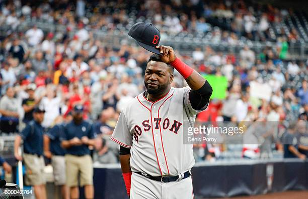 David Ortiz of the Boston Red Sox tips his cap to the crowd during a pregame ceremony honoring him prior to a baseball game against the San Diego...