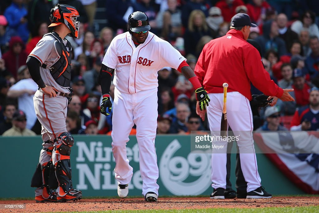 David Ortiz #34 of the Boston Red Sox tosses his bat after being ejected during the fifth inning against the Baltimore Orioles for arguing a check swing strike at Fenway Park on April 19, 2015 in Boston, Massachusetts.
