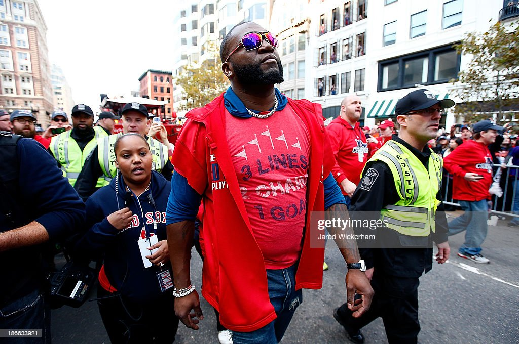 David Ortiz #34 of the Boston Red Sox walks down Boylston Street near the finish line of the Boston Marathon during the World Series victory parade on November 2, 2013 in Boston, Massachusetts.