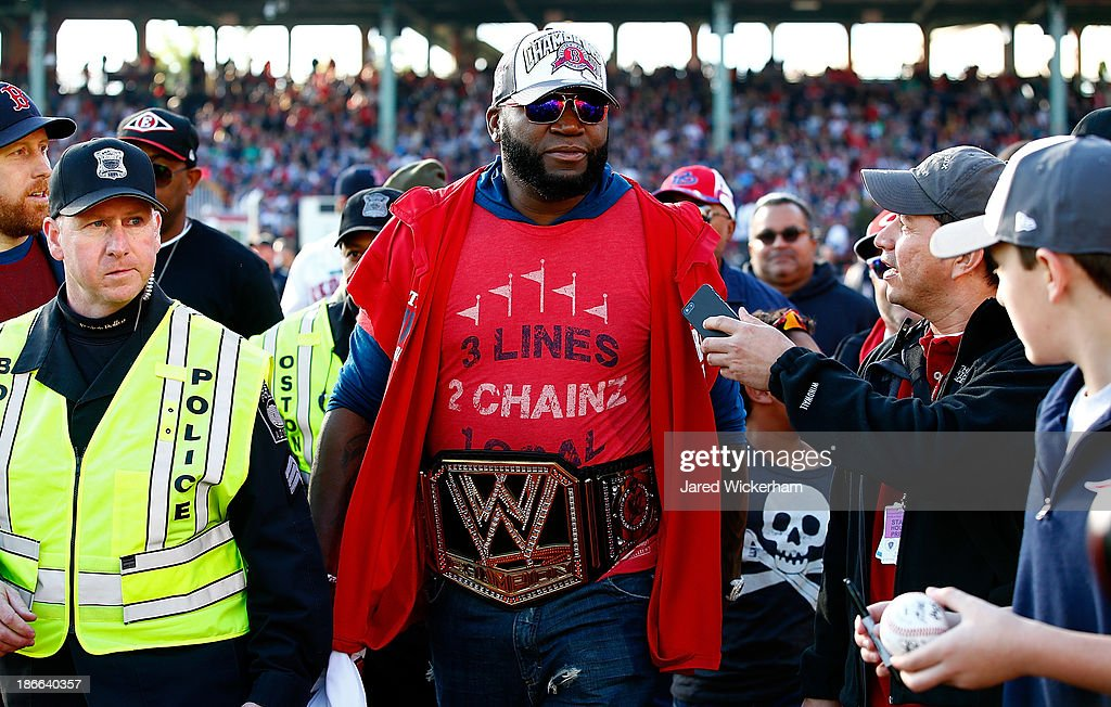 David Ortiz #34 of the Boston Red Sox walks to his float while wearing a wrestling belt during the World Series victory parade at Fenway Park on November 2, 2013 in Boston, Massachusetts.