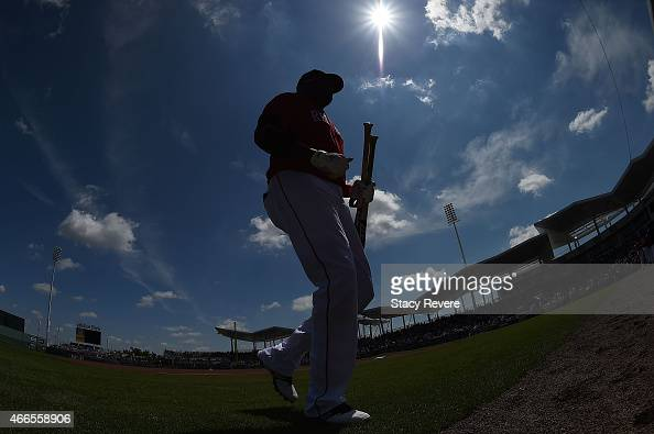 David Ortiz of the Boston Red Sox walks to the dugout prior to a spring training game against the New York Mets at JetBlue Park at Fenway South on...