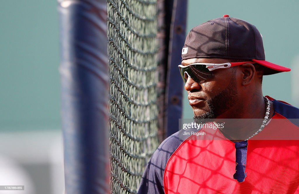 David Ortiz #34 of the Boston Red Sox watches batting practice before a game with the Baltimore Orioles at Fenway Park on August 28, 2013 in Boston, Massachusetts.