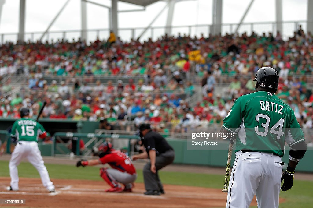 David Ortiz #34 of the Boston Red Sox watches Dustin Pedroia #15 during the first inning of a game against the St. Louis Cardinals at JetBlue Park at Fenway South on March 17, 2014 in Fort Myers, Florida. Boston won the game 10-5.