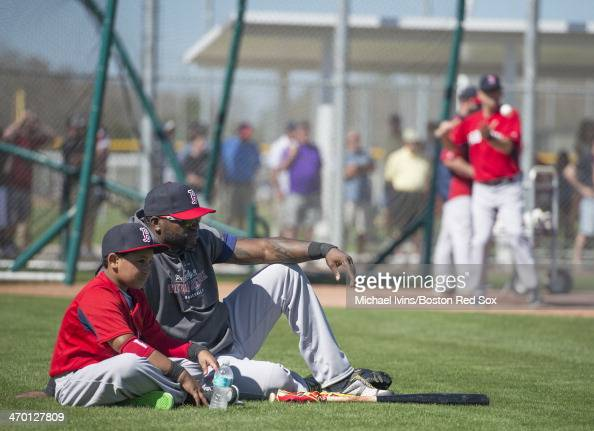 David Ortiz of the Boston Red Sox watches infield drills with his son D'Angelo during a Spring Training workout at Fenway South on February 18 2014...
