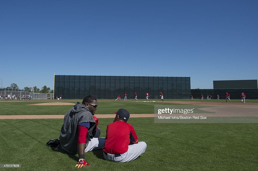 David Ortiz #34 of the Boston Red Sox watches infield drills with his son D'Angelo during a Spring Training workout at Fenway South on February 18, 2014 in Fort Myers, Florida.