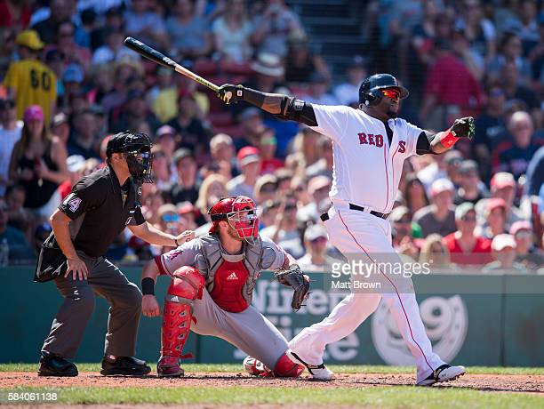 David Ortiz of the Boston Red Sox watches the flight of his ball with umpire Mark Wegner and catcher Jett Bandy of the Los Angeles Angels of Anaheim...
