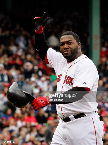 David Ortiz of the Boston Red Sox waves to fans after he was replaced by a pinch runner against the New York Yankees at Fenway Park October 3 in...