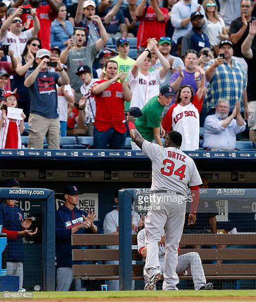 David Ortiz of the Boston Red Sox waves to fans as he makes his last appearance at Turner Field during the second inning of a baseball game at Turner...