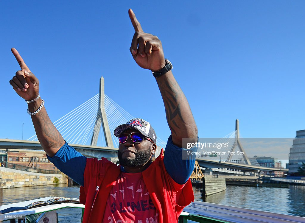 David Ortiz #34 of the Boston Red Sox waves to fans during a victory parade on November 2, 2013 through Boston, Massachusetts.