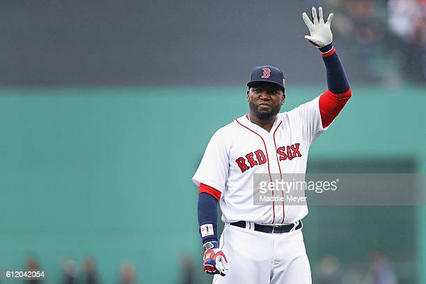 David Ortiz of the Boston Red Sox waves to fans during the pregame ceremony to honor his retirement before his last regular season home game at...