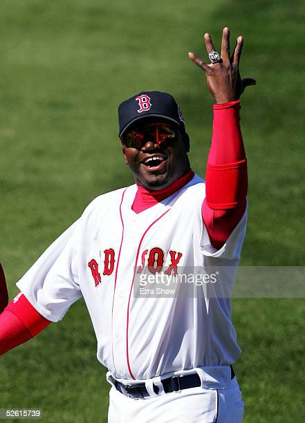 David Ortiz of the Boston Red Sox waves to the crowd after he received his 2004 World Series Championship ring before their game against the New York...