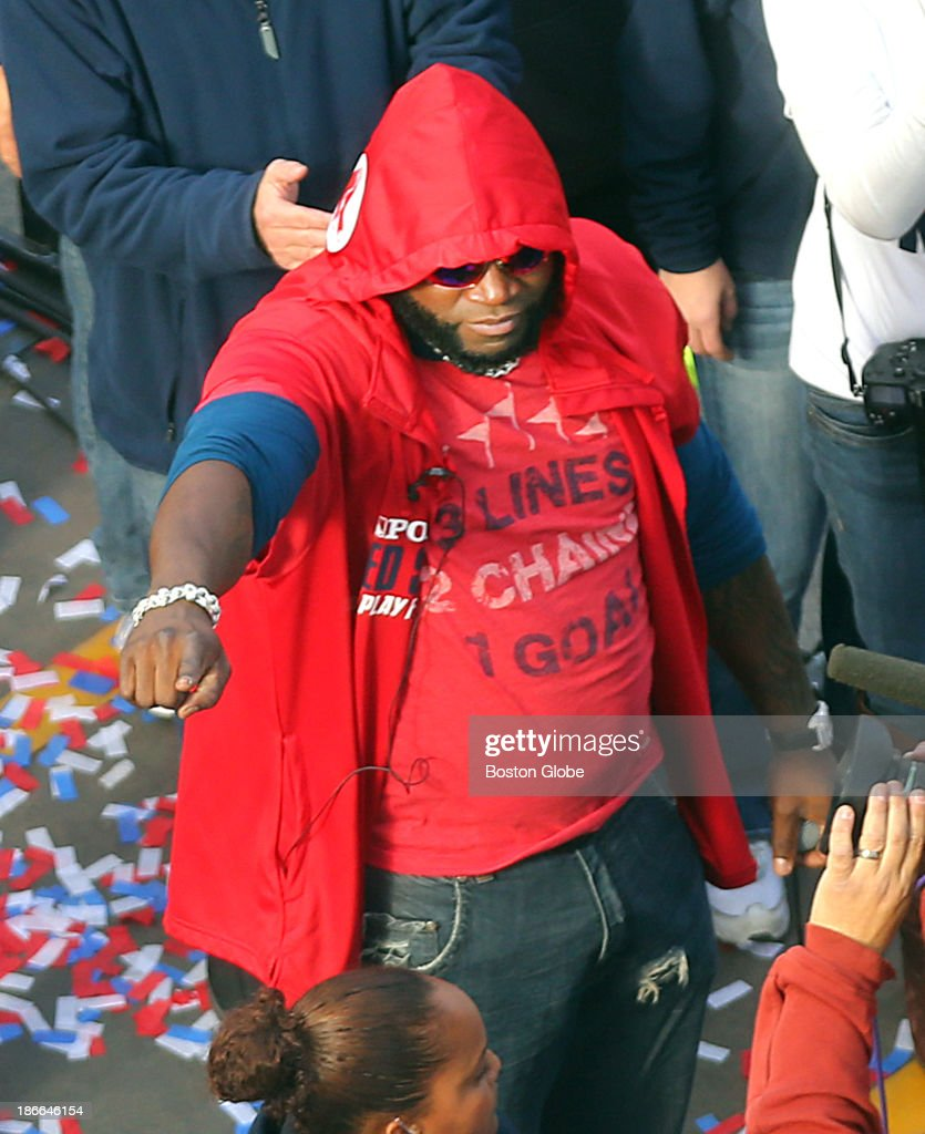 David Ortiz points to the crowd as fans lined Boylston Street in the Back Bay to watch the Boston Red Sox celebrate their World Series victory with a Rolling Rally duck boat parade on Saturday, Nov. 2, 2013.