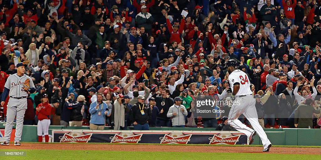 David Ortiz rounds the bases following his eighth inning grand slam that tied the game at 5-5. Tigers third baseman Miguel Cabrera is at left. The Boston Red Sox hosted the Detroit Tigers in Game Two of the American League Championship Series at Fenway Park.