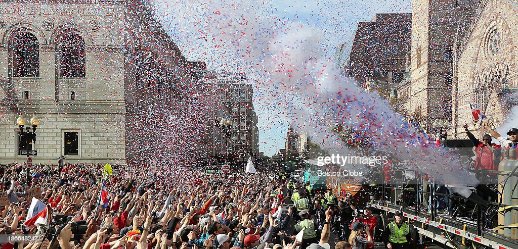 MVP David Ortiz waves to the crowd in Copley Square as the Boston Red Sox celebrate their World Series victory with a Rolling Rally duck boat parade on Saturday, Nov. 2, 2013.