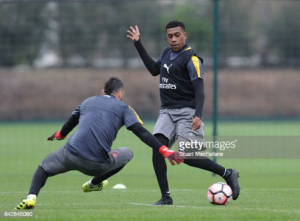 David Ospina and Alex Iwobi of Arsenal during a training session on February 19 2017 in St Albans England