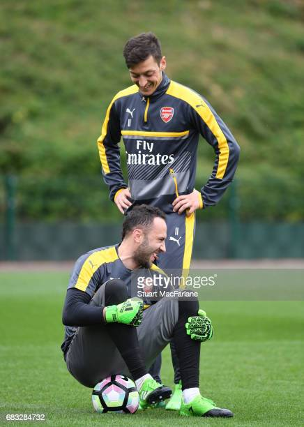 David Ospina and Mesut Ozil of Arsenal during a training session at London Colney on May 15 2017 in St Albans England