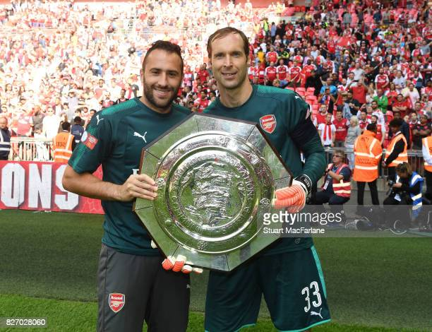 David Ospina and Petr Cech of Arsenal with the Community shield after the FA Community Shield match between Chelsea and Arsenal at Wembley Stadium on...
