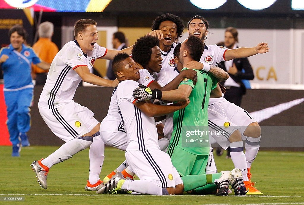 David Ospina goalkeeper of Colombia celebrates with his teammates after making the final save in the shootout during a Quarterfinal match between...