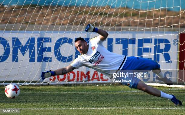 David Ospina goalkeeper of Colombia dives for the ball during a training session at Autonoma del Caribe University Sports Center on March 20 2017 in...
