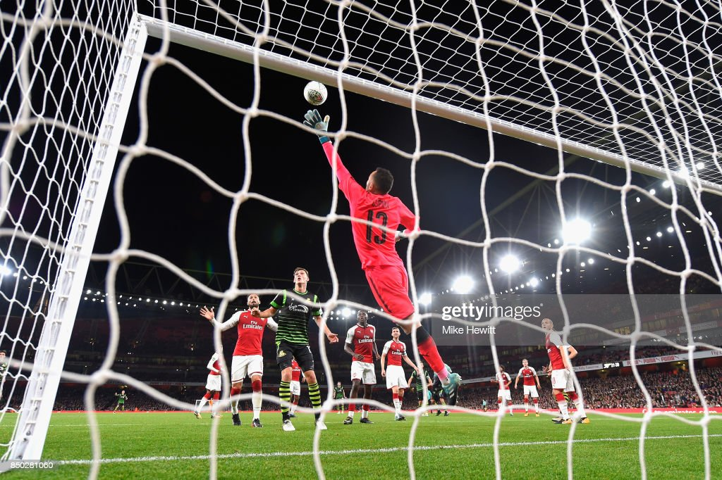 David Ospina of Arsenal dives to make a save during the Carabao Cup Third Round match between Arsenal and Doncaster Rovers at Emirates Stadium on September 20, 2017 in London, England.