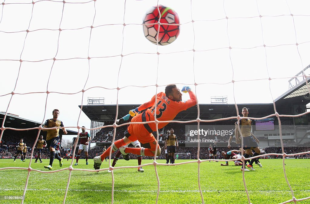 David Ospina of Arsenal fails to stop as Andy Carroll (3rd R) of West Ham United scores his team's second goal during the Barclays Premier League match between West Ham United and Arsenal at the Boleyn Ground on April 9, 2016 in London, England.