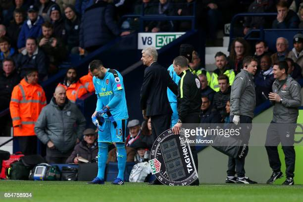 David Ospina of Arsenal prepares to come on for Petr Cech of Arsenal who goes off injured during the Premier League match between West Bromwich...