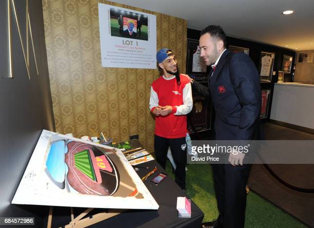 David Ospina of Arsenal with local artist Stazzy at the Arsenal Foundation Charity Ball 'A Night to Inspire' on May 18 2017 in London England