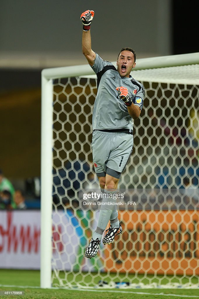 <a gi-track='captionPersonalityLinkClicked' href=/galleries/search?phrase=David+Ospina&family=editorial&specificpeople=4104267 ng-click='$event.stopPropagation()'>David Ospina</a> of Colombia celebrates during the 2014 FIFA World Cup Brazil Group C match between Japan and Colombia at Arena Pantanal on June 24, 2014 in Cuiaba, Brazil.