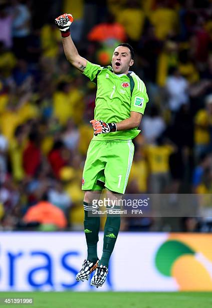 David Ospina of Colombia celebrates his team's first goal by James Rodriguez during the 2014 FIFA World Cup Brazil Round of 16 match between Colombia...