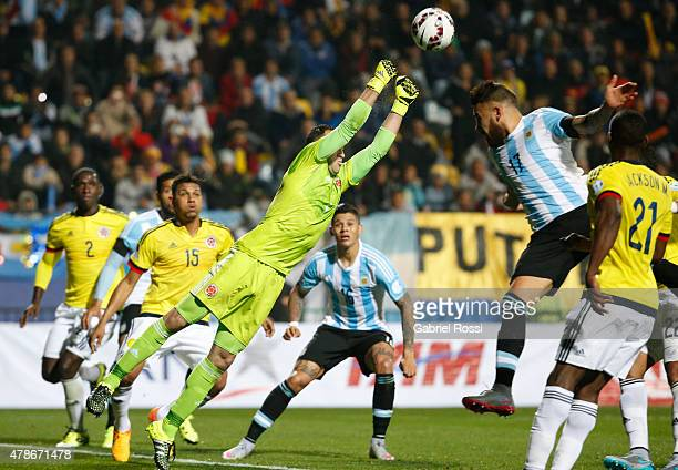 David Ospina of Colombia goes for the ball with Nicolas Otamendi of Argentina during the 2015 Copa America Chile quarter final match between...