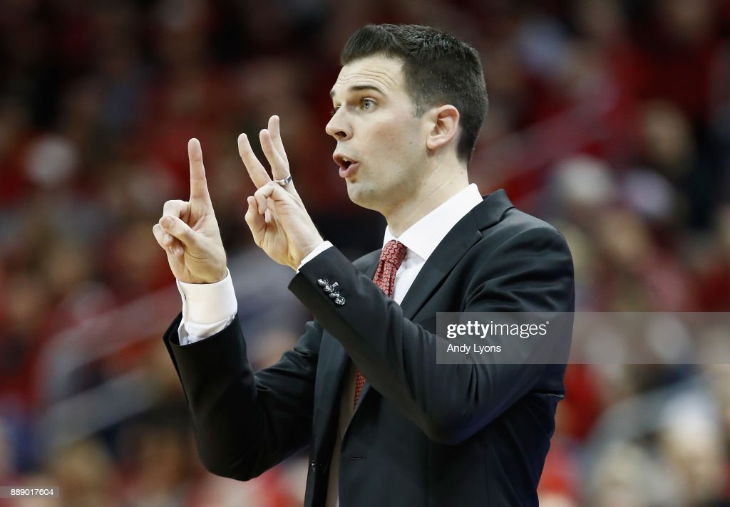 David Padgett the head coach of the Louisville Cardinals gives instructions to his team during the game against the Indiana Hoosiers at KFC YUM! Center on December 9, 2017 in Louisville, Kentucky.