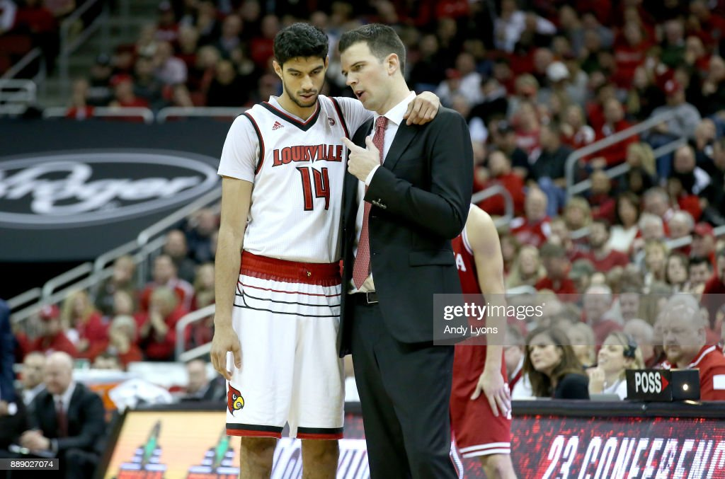 David Padgett the head coach of the Louisville Cardinals gives instructions to Anas Mahmoud #14 during the game against the Indiana Hoosiers at KFC YUM! Center on December 9, 2017 in Louisville, Kentucky.