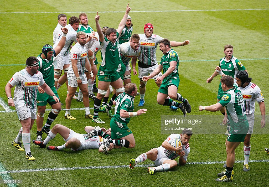 David Paice, try scorer, and Brendan McKibbin of Irish celebrate scoring a try with their team mates during the Aviva Premiership match between London Irish and Harlequins at the Madejski Stadium on 1 May, 2016 in Reading, England.