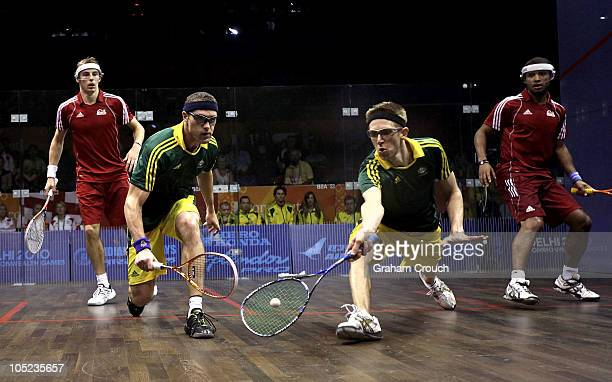 David Palmer and Stewart Boswell of Australia compete for the ball against Nick Mathew and Adrian Grant of England in the mens doubles gold medal...