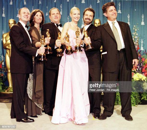 David Parfitt Donna Gigliotti Harvey Weinstein Gwyneth Paltrow Edward Zwick and Marc Norman all celebrate after receiving the Oscar for best picture...