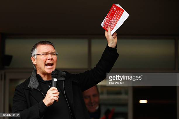 David Parker of the Labour Party speaks outside the US Embassy following a protest march down Queen Street on August 15 2015 in Auckland New Zealand...