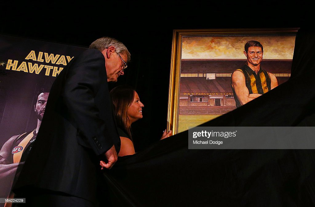 David Parkin undrapes his portrait after being inducted as a legend during the Hawthorn Hawks Season Launch and Hall of Fame presentation at Encore St Kilda on March 21, 2013 in Melbourne, Australia.