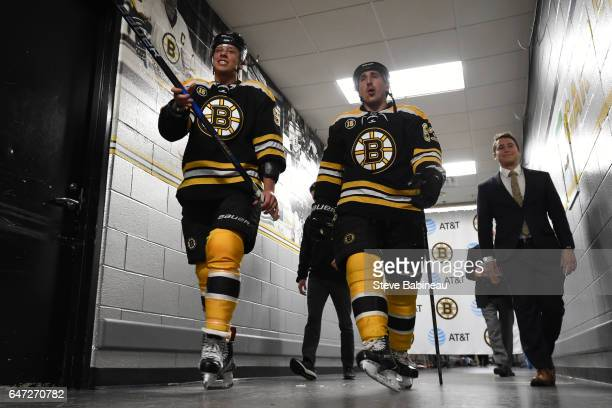 David Pastrnak and Brad Marchand of the Boston Bruins walk to the locker room after warm ups before the game against the New York Rangers at the TD...