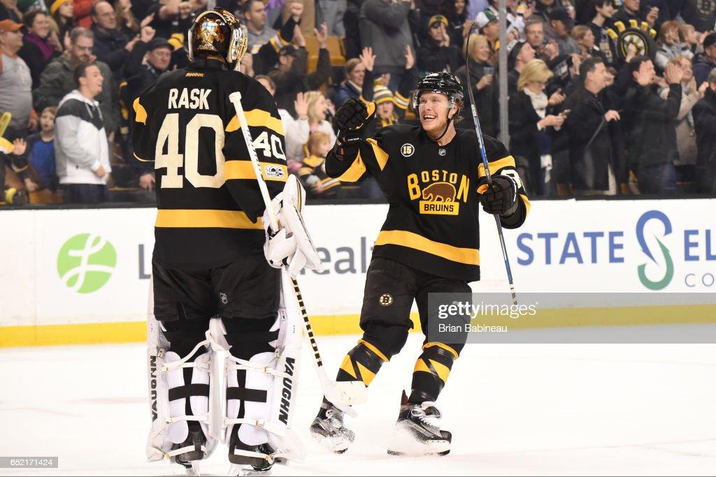 David Pastrnak #88 and Tuukka Rask #40 of the Boston Bruins celebrate a goal against the Philadelphia Flyers at the TD Garden on March 11, 2017 in Boston, Massachusetts.