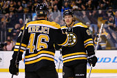 David Pastrnak congratulates David Krejci of the Boston Bruins after he scored a goal in the first period against the Dallas Stars at TD Garden on...