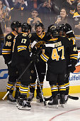 David Pastrnak of the Boston Bruins and his linemates celebrate a goal against the Tampa Bay Lightning at the TD Garden on January 13 2015 in Boston...